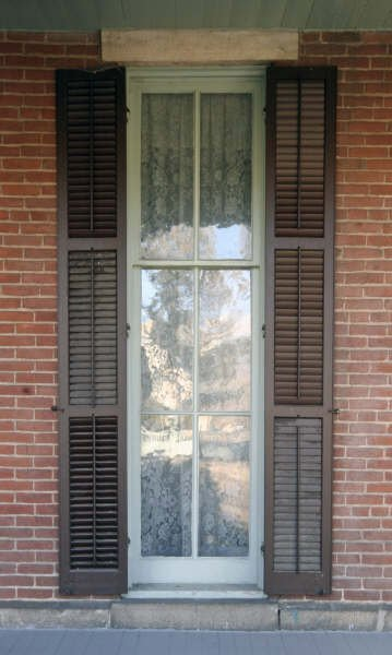 Windows of house that open to be used as doors