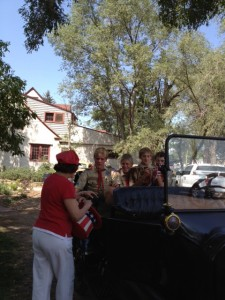 And the Scouts are off for a ride downtown in a Model T Ford